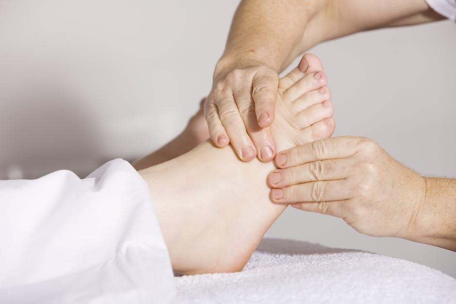 foot massaging patient